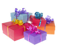 Colorful present boxes with ribbon stacked. Asymetrically and randomly isolated on white background Royalty Free Stock Image