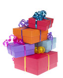 Colorful present boxes with ribbon stacked. Asymetrically and randomly isolated on white background Stock Photography