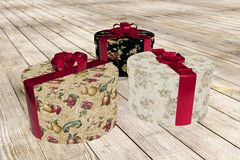 Colorful present boxes on wooden floor Stock Photography