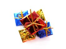 Colorful presents. Colorful, shiny presents isolated on white royalty free stock photos
