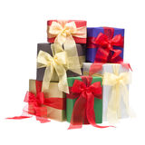 Colorful presents in a studio setting. Over white royalty free stock image