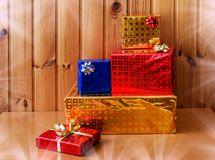 Colorful presents  on wooden background. Colorful shiny presents with gift bows on wooden background Stock Images