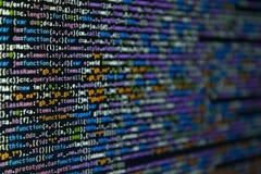 Program code on dark background. Colorful program code on dark background. Selective focus stock photos