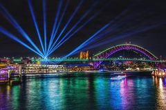 Colorful projection lights above city in night stock photography