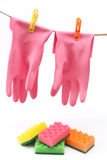 Colorful  protective gloves and sponges Royalty Free Stock Photography