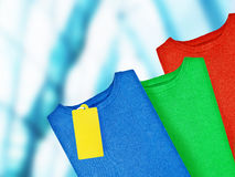 Colorful pullovers with label Stock Images