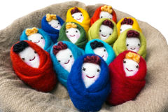 Colorful puppets. Handmade. baby in the cradle stock image