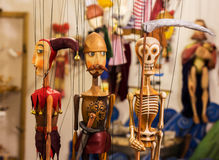 Colorful puppets in prague. Three color full prague puppets Stock Images
