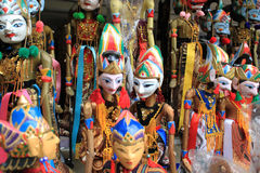 Colorful puppets on stall in Bali. Colorful puppets with white faces in Bali royalty free stock image