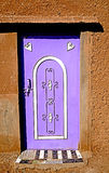 A typical colored door in a Berber village in Morocco stock images