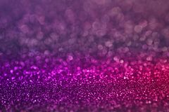 Colorful purple pink bokeh light glitter background for Christmas and New Year`s day. Festive background Stock Images