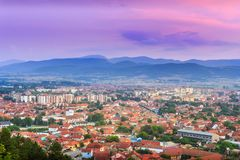 Colorful purple sunset sky over Pirot city stock photos
