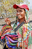 Colorful purse vendor with baseball hat stock photography