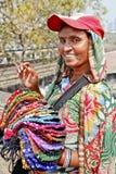 Colorful purse vendor with baseball hat. Mumbai, India at the tourist spot, Dhobhi Ghat, portrait of smiling colorful smiling purse street vendor with baseball stock photography