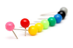 Colorful Push Pin. Aligned in a row on white background stock photos