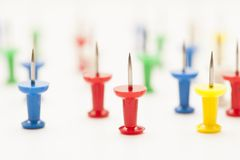 Colorful push pins Stock Photos