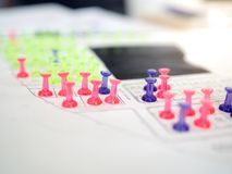 Colorful push pins marking for real estate resevation royalty free stock image