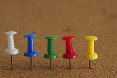 Colorful push pins in a row Royalty Free Stock Photos