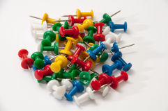 Colorful push pins on the white background Royalty Free Stock Photos