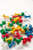 Colorful push pins on the white background Stock Image
