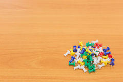 Colorful push pins on wooden background. with copy space Royalty Free Stock Photo