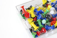Colorful pushpin texture inside glass box, push pins on the whit Royalty Free Stock Photo