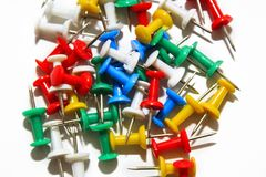 Colorful pushpins on white background royalty free stock images
