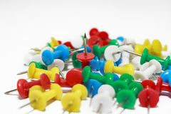 Colorful pushpins on white background stock photography