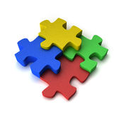 Colorful puzzle. Four puzzle pieces interconnected with each other over white background Stock Photography