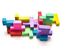 Colorful Puzzle. Colorful pieces of a rubber jigsaw puzzle on a white background royalty free stock photos