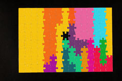 Colorful puzzle. On black background Stock Photos