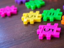 Colorful puzzle Jigsaw plastic number on the wooden table. Concept of education and math learning.  stock image