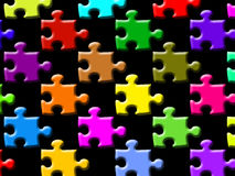 Colorful puzzle pieces. A black background with colorful puzzle pieces Royalty Free Stock Images