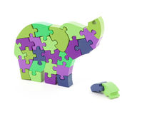 Colorful puzzle pieces in elephant shape Royalty Free Stock Photos