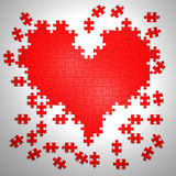 Colorful puzzle pieces in heart shape Royalty Free Stock Photography