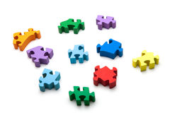 Colorful puzzle pieces on white background. Wooden puzzle Royalty Free Stock Photos