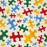 Colorful puzzle seamless pattern in wood texture Royalty Free Stock Images