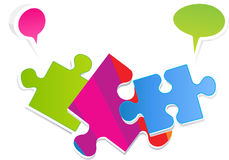 Colorful puzzle with speech bubbles. This 3D vector illustration is good for visually representing the importance of teamwork, management, communication, or Royalty Free Stock Image