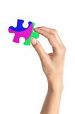 Colorful puzzle in woman hand isolated on white Royalty Free Stock Images