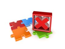Colorful puzzles and red cross mark. Royalty Free Stock Image