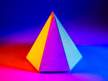 Colorful pyramid solid. 3d illustration of a colorful pyramid solid shape stock photography