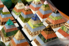 Colorful pyramids Stock Images
