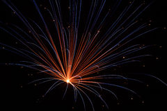 Colorful Pyrotechnic. Colorful fireworks explosion fills the night sky with brilliant light Stock Photography