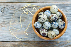 Colorful quail eggs in a wooden bowl. Royalty Free Stock Photos