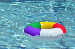 A Colorful Raft Floating in the Pool. A colorful inflatable ring floating in a pool Royalty Free Stock Photos