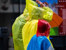 Colorful rain jackets in the rain