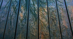 Colorful Rain Patterns on Blue Deck Royalty Free Stock Image