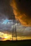 Colorful rain storm next energy line Stock Photography