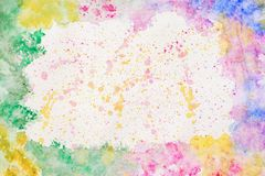 Colorful rainbow border for text or banner, card, template, design, formed by hand painted with bright blots, splashes. Of watercolor on paper. Abstract Royalty Free Stock Photography