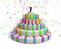 Colorful rainbow cake with on top a chocolate number 7 Royalty Free Stock Photography